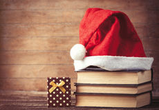 Santas hat over books near gift box Royalty Free Stock Image