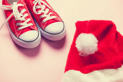Santas hat and red gumshoes Stock Photos