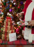 Santas Haveing His Treats Stock Photo