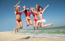 Santas having fun on the beach Royalty Free Stock Photos