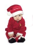 Santas helper. Close up of cute baby boy in santa hat royalty free stock photo