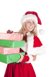 Santas helper holding presents looking back Royalty Free Stock Image