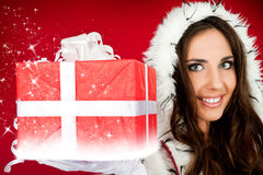 Santas helper holding sparkly Christmas present Stock Image