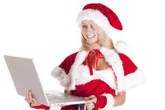 Santas helper laptop smiling Royalty Free Stock Photography
