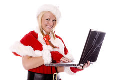 Santas helper making list on computer and smiling Stock Photography