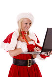 Santas helper making list with laptop Stock Images