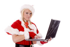 Santas helper making naughty list on computer Stock Photo
