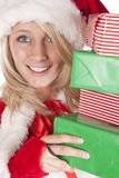Santas helper peeking around presents Royalty Free Stock Image