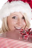 Santas helper peeking over present Royalty Free Stock Image