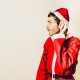 Santas little helper listening to christmas orders Stock Photo