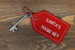 Santas magic key on a wooden background Stock Photos