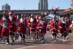 Santas op een looppas in de Haven van de Schat. Stock Afbeelding