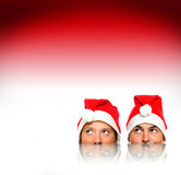 Santas over red background Stock Photo