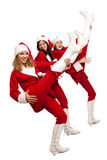 Santas  playing on legs like on guitars Royalty Free Stock Images