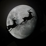 Santas rein deers flying with moon Royalty Free Stock Image
