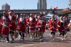 Santas on a run in Darling Harbour. Stock Image
