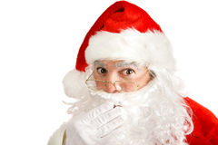 Santas Secret. Closeup of Santa Clause covering his mouth like he has a secret he can't tell.  Isolated on white Royalty Free Stock Images