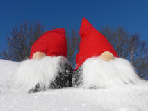 Santas on Snowy Slope. Two santas on a snowy slope on a bright sunny winter day Stock Photos