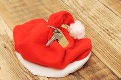 Santas som är nyckel- med den tomma etiketten Arkivfoto