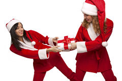 Santas take from  each other a gift box Stock Photo