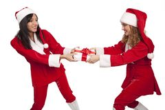 Santas take from  each other a gift box Stock Photos