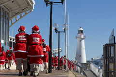 Santas are on a walk. Stock Images