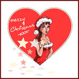 Santas wife in a red dress wishing you a merry christmas Royalty Free Stock Photography