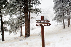 Santas workshop this way sign in snow scene Royalty Free Stock Photo