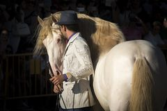 Santi Serra with one of his stunning horses in an exhibition in Lugo, Spain, August 2016. Santi Serra, Spanish horseman, with one of his awesome trained horses royalty free stock photos