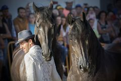 Santi Serra with two of his Friesian horses in a horse fair in Lugo, Spain stock photography