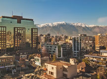 Santiago and the Andes. Santiago, June 2013. Financial and residential district Las Condes with The Andes mountains covered with snow on background Stock Images