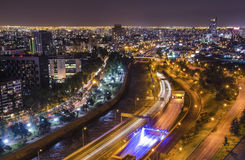 Night view of Santiago de Chile toward the east part of the city, showing the Mapocho river and Providencia and Las Condes distric Stock Photos