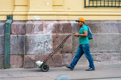 People of Chile. SANTIAGO, CHILE - NOV 1, 2014:  Unidentified Chilean man with a carriage in Santiago. Chilean people are mainly of mixed Spanish and Amerindian Stock Photography