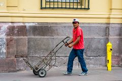 People of Chile. SANTIAGO, CHILE - NOV 1, 2014:  Unidentified Chilean man with a carriage in Santiago. Chilean people are mainly of mixed Spanish and Amerindian Royalty Free Stock Photography
