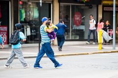 People of Chile. SANTIAGO, CHILE - NOV 1, 2014:  Unidentified Chilean man carries his baby. Chilean people are mainly of mixed Spanish and Amerindian descent Royalty Free Stock Photography