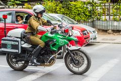 People of Chile. SANTIAGO, CHILE - NOV 1, 2014:  Unidentified Chilean man on the motorcycle. Chilean people are mainly of mixed Spanish and Amerindian descent Stock Photography
