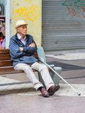 People of Chile. SANTIAGO, CHILE - NOV 1, 2014:  Unidentified Chilean old man sits on a bench in Santiago. Chilean people are mainly of mixed Spanish and Royalty Free Stock Images