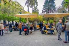 SANTIAGO, CHILE - OCTOBER 16, 2018: Outdoor view of crowd of people playing chess in in the sidewalk in Santiago, Chile stock photos