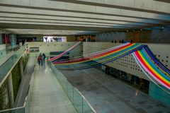 SANTIAGO, CHILE - SEPTEMBER 13, 2018: Costanera Center mall interior, with some rainbow structures hanging in top of the Royalty Free Stock Photos