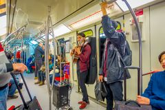 SANTIAGO, CHILE - SEPTEMBER 14, 2018: Indoor view of unidentified people inside of electric train on central railway. Station in Santiago, Chile with a musician stock images