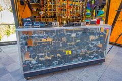 SANTIAGO, CHILE - SEPTEMBER 13, 2018: Outdoor view of assorted camera models inside of a showcase located in the streets royalty free stock photos