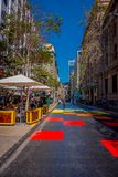 SANTIAGO, CHILE - SEPTEMBER 13, 2018: Outdoor view of crowd of people walking in the colorful streets the downtown Stock Photos
