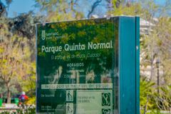 SANTIAGO, CHILE - SEPTEMBER 13, 2018: Outdoor view of informative sign of Park Quinta Normal over a green structure in. The Barrio Yungay in Santiago, capital Stock Photos