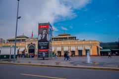 SANTIAGO, CHILE - SEPTEMBER 13, 2018: Outdoor view of people walking in front of market near central bust station in. Santiago de Chile stock image