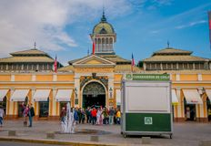 SANTIAGO, CHILE - SEPTEMBER 13, 2018: Outdoor view of people walking in front of market near central bust station in. Santiago de Chile royalty free stock image