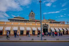 SANTIAGO, CHILE - SEPTEMBER 13, 2018: Outdoor view of people walking in front of market near central bust station in. Santiago de Chile royalty free stock images