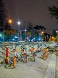 SANTIAGO, CHILE - SEPTEMBER 14, 2018: Outdoor view of public bikes for rent located an the enter of central railway. Station in Santiago, Chile, at night stock photography
