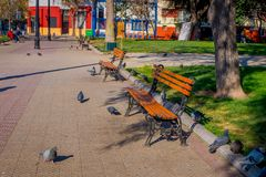 SANTIAGO, CHILE - SEPTEMBER 13, 2018: Outdoor view of public wooden chair at Yungay park located in the Barrio Yungay in. Santiago, capital of Chile during Royalty Free Stock Image