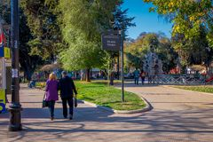 SANTIAGO, CHILE - SEPTEMBER 13, 2018: Outdoor view of unidentified people walking in the Yungay park located in the. Barrio Yungay in Santiago, capital of Chile Stock Images