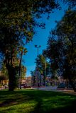 SANTIAGO, CHILE - SEPTEMBER 13, 2018: Outdoor view of unidentified people walking in the Yungay park located in the. Barrio Yungay in Santiago, capital of Chile Stock Photos